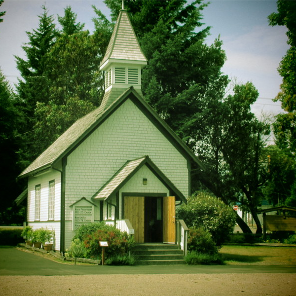 A small wooden church painted white
