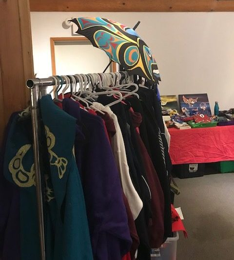 A clothing rack hanging coast salish-design clothes