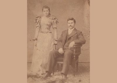 A formal studio photograph of a young white couple