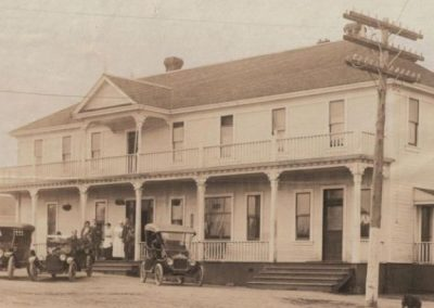 The large elegant Rod and Gun Hotel, 1910, with card parked in front
