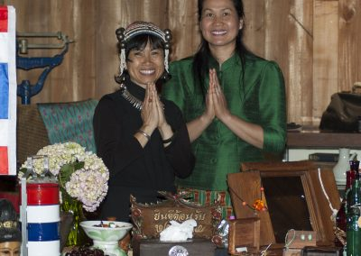Two Thai women smiling